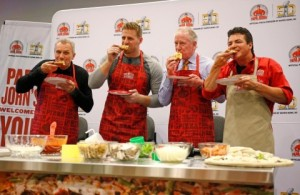 The Papa John's team celebrates the launch of its Quality Guarantee at Super Bowl 50. (Graphic courtesy of Business Wire)