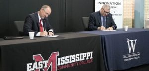 EMCC President Dr. Thomas Huebner, left, and MUW President Dr. Jim Borsig formally sign a new articulation agreement to benefit Manufacturing Technology & Engineering graduates from EMCC. (Photo courtesy of MUW University Relations)
