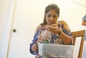 Anmol Narang, a senior at Brookhaven Academy, sorts materials at the iCreate pop-up shop at Mississippi State's Visual Arts Center on Saturday afternoon. The shop featured the work of students who attended an entrepreneurial camp at the university this week. Photo by: Mary Alice Truitt/Dispatch Staff