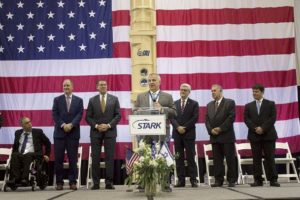Stark Aerospace CEO Tom Ronaldi, flanked by Mississippi and Israeli officials, thanks guests for attending a commemoration event for the delivery of a missile defense canister to Israel - Alex Holloway, Dispatch Staff
