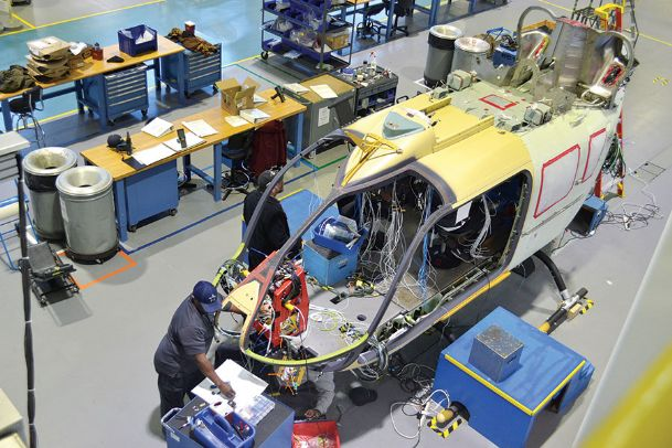 Airbus employees complete wiring on the Lakota UH-72A helicopter for the U.S. Army in Columbus on Tuesday morning - Mary Pollitz, Dispatch Staff